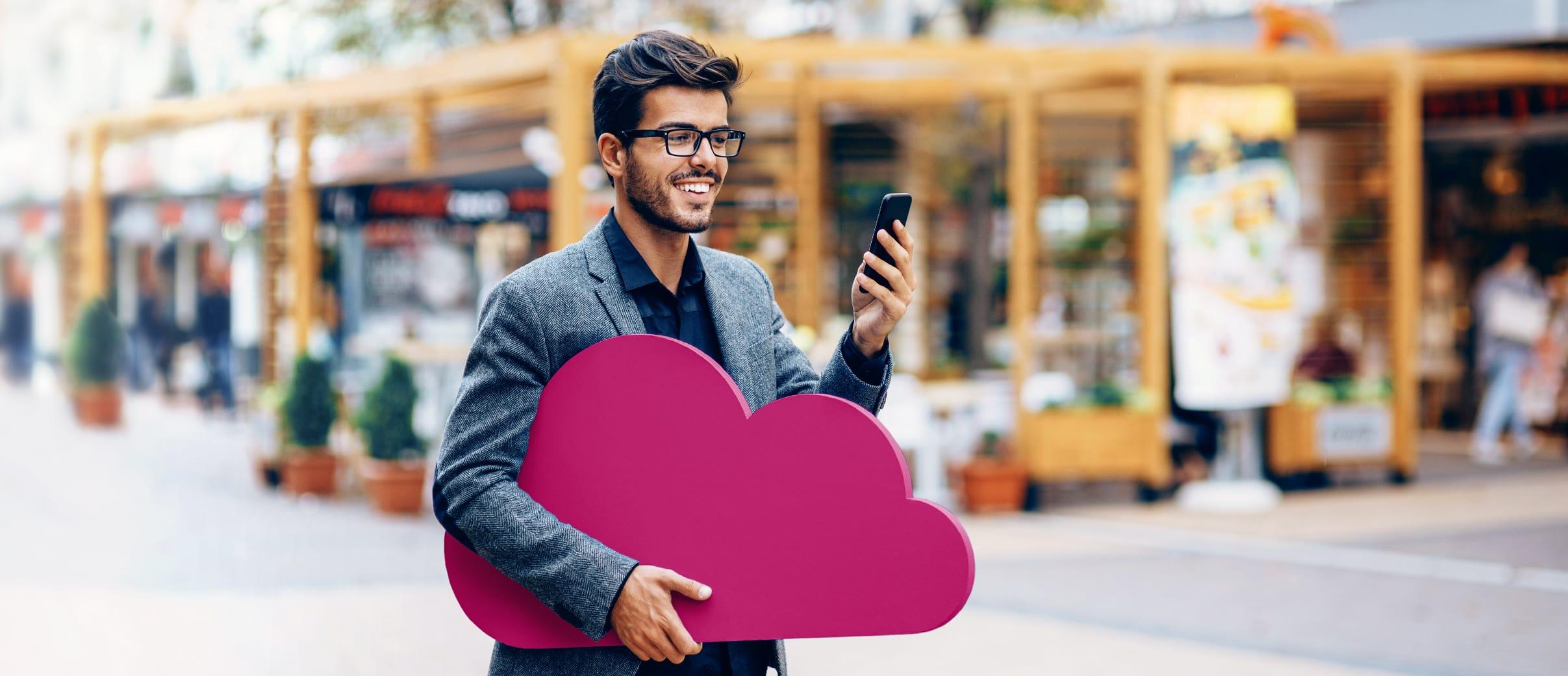 Cloud Service - Man with Signavio Cloud in hand