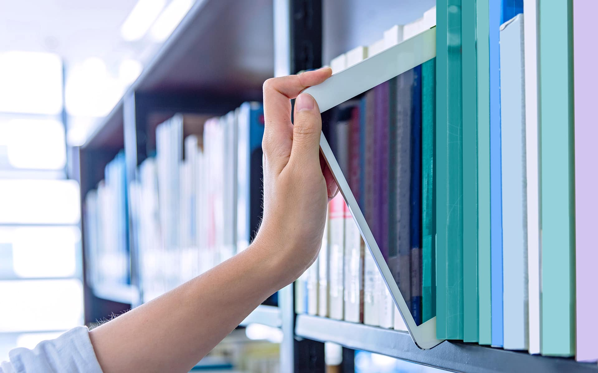 Ipad stored in a book shelve indicating to work paperless