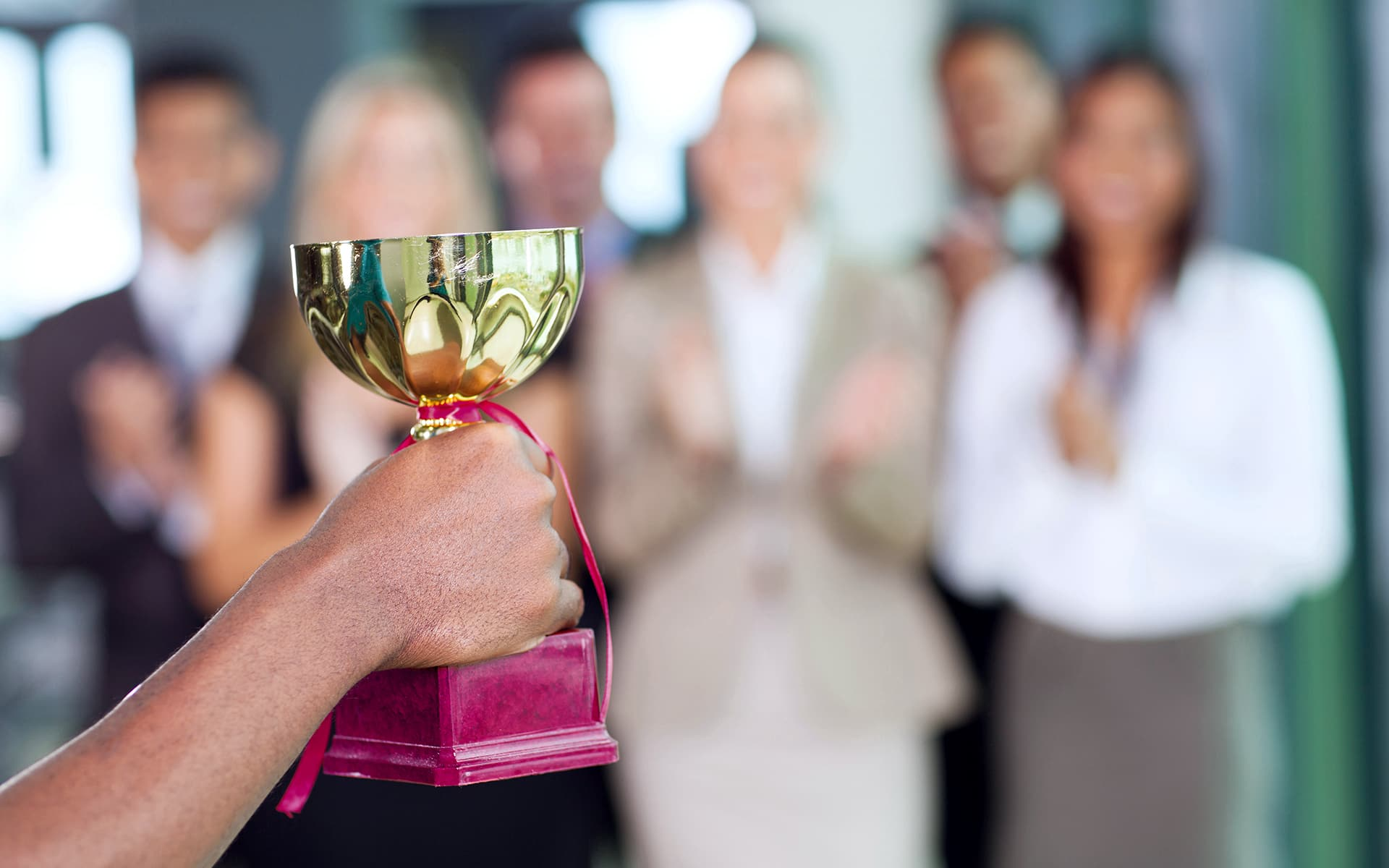 Signavio Awards and Recognition - Cup in hand