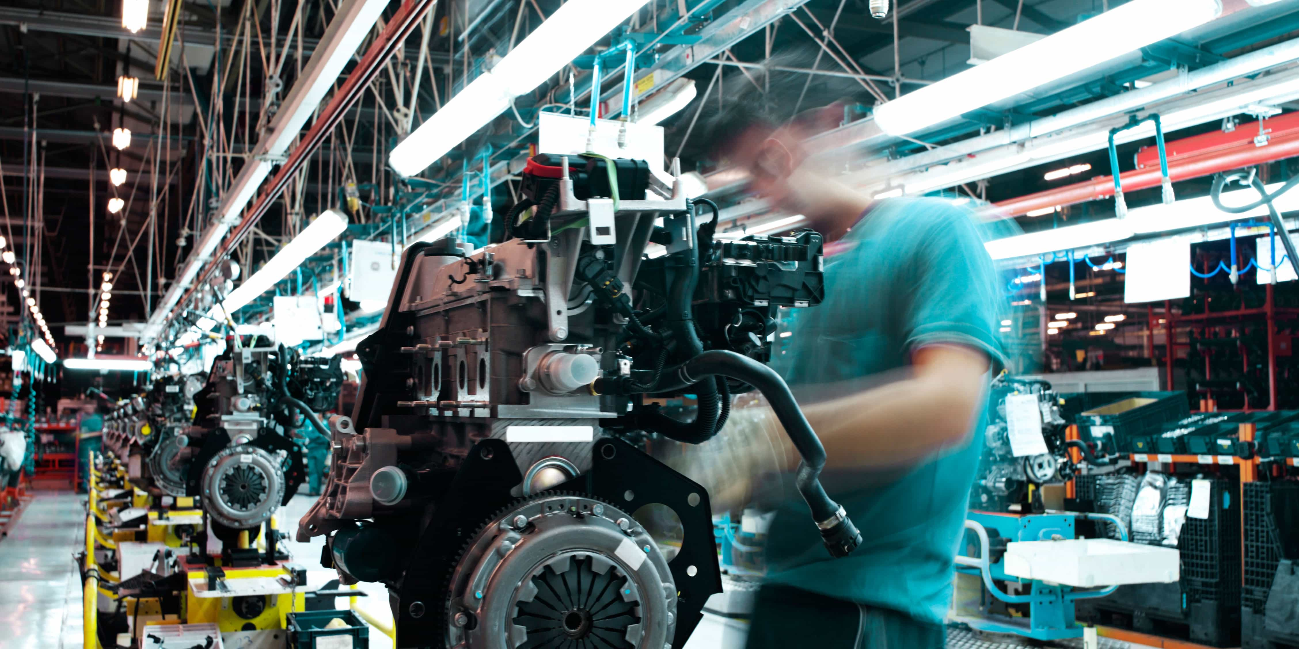Product Lifecycle Management - Man working on a car engine