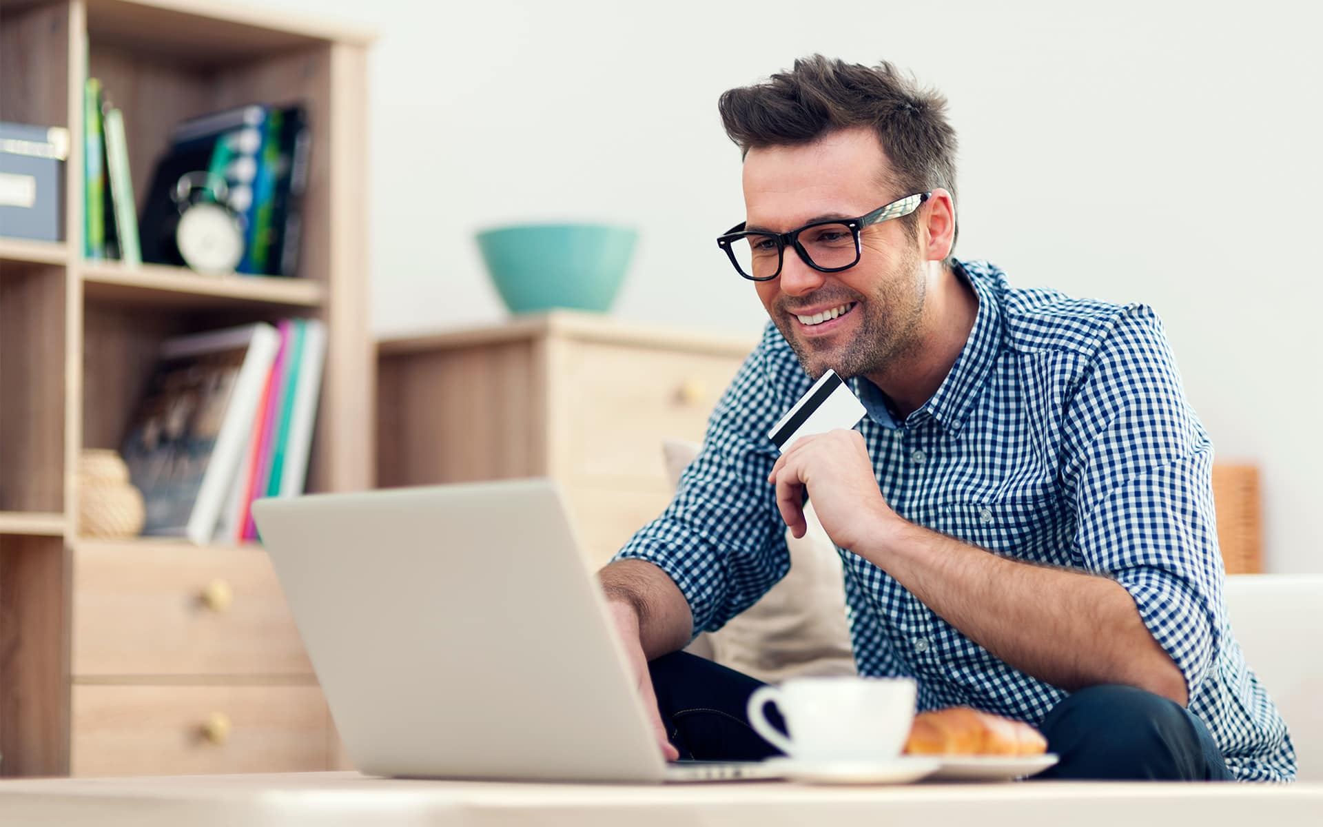 Resolving the compliance/customer experience challenge - man in front of a computer