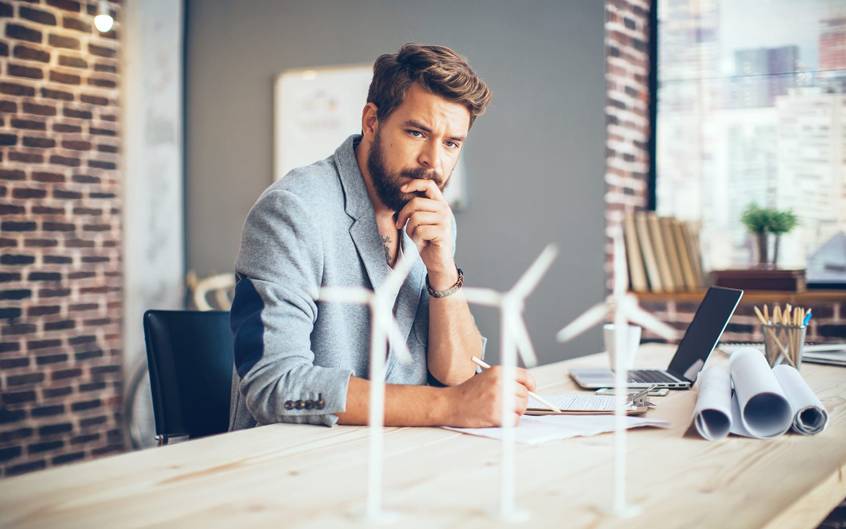 Implementing Product Lifecycle Management - man watching his windmills at the table