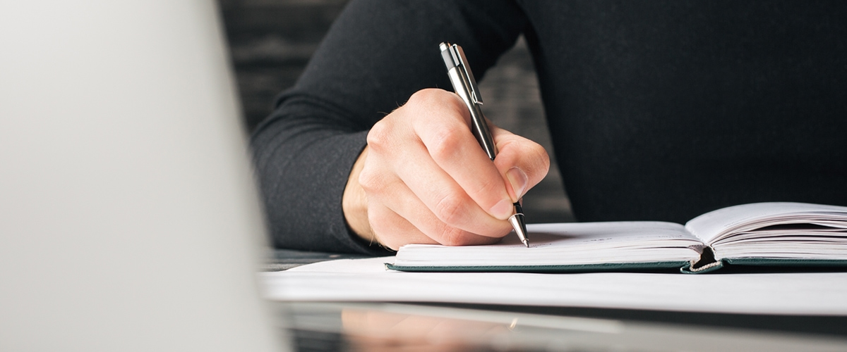 DocuSign workflow - hand with pen signing a document
