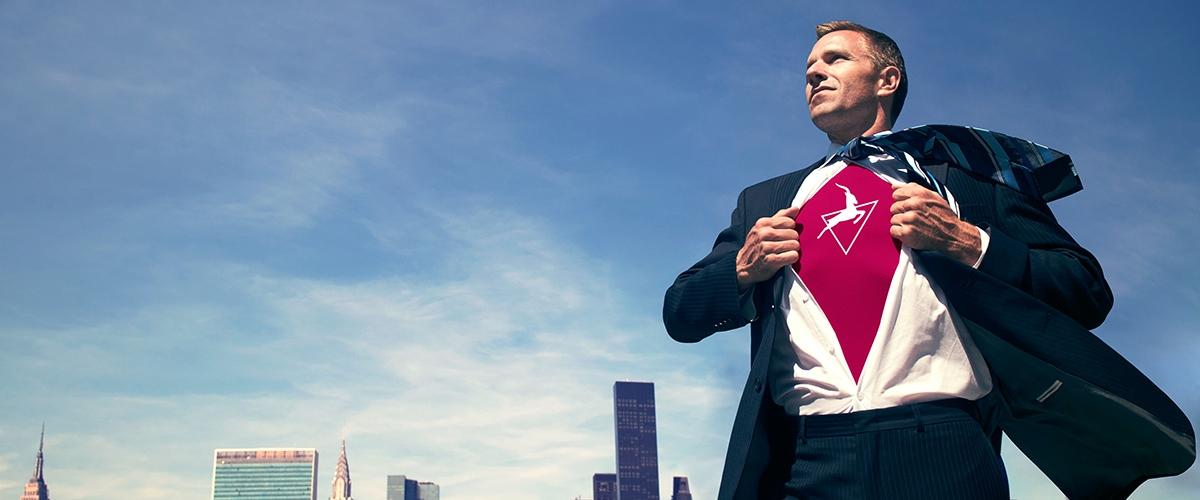 Process Intelligence Superhero -A businessman pulling open his shirt to reveal the Signavio logo.