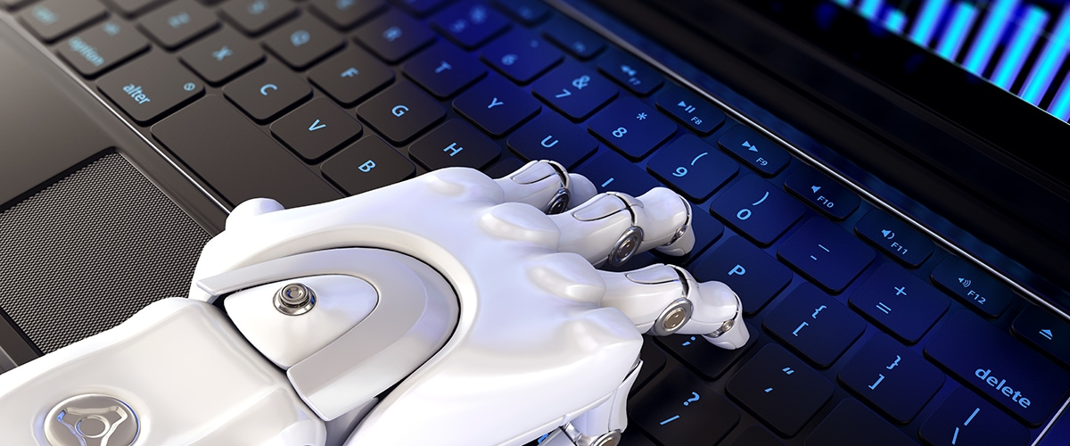 Robotic Process Automation - A white metallic robotic hand types on a computer keyboard