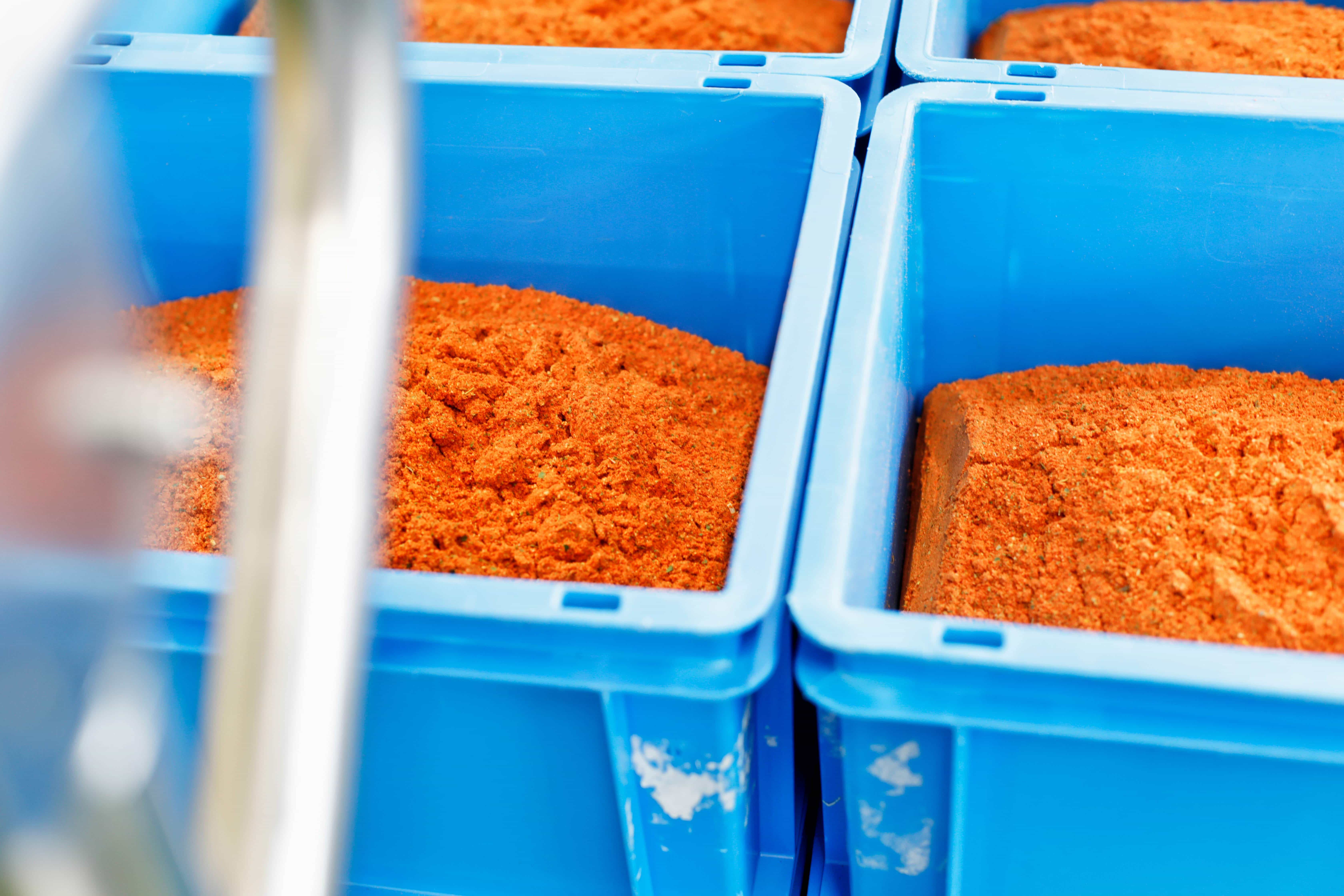 Orange spices in blue boxes