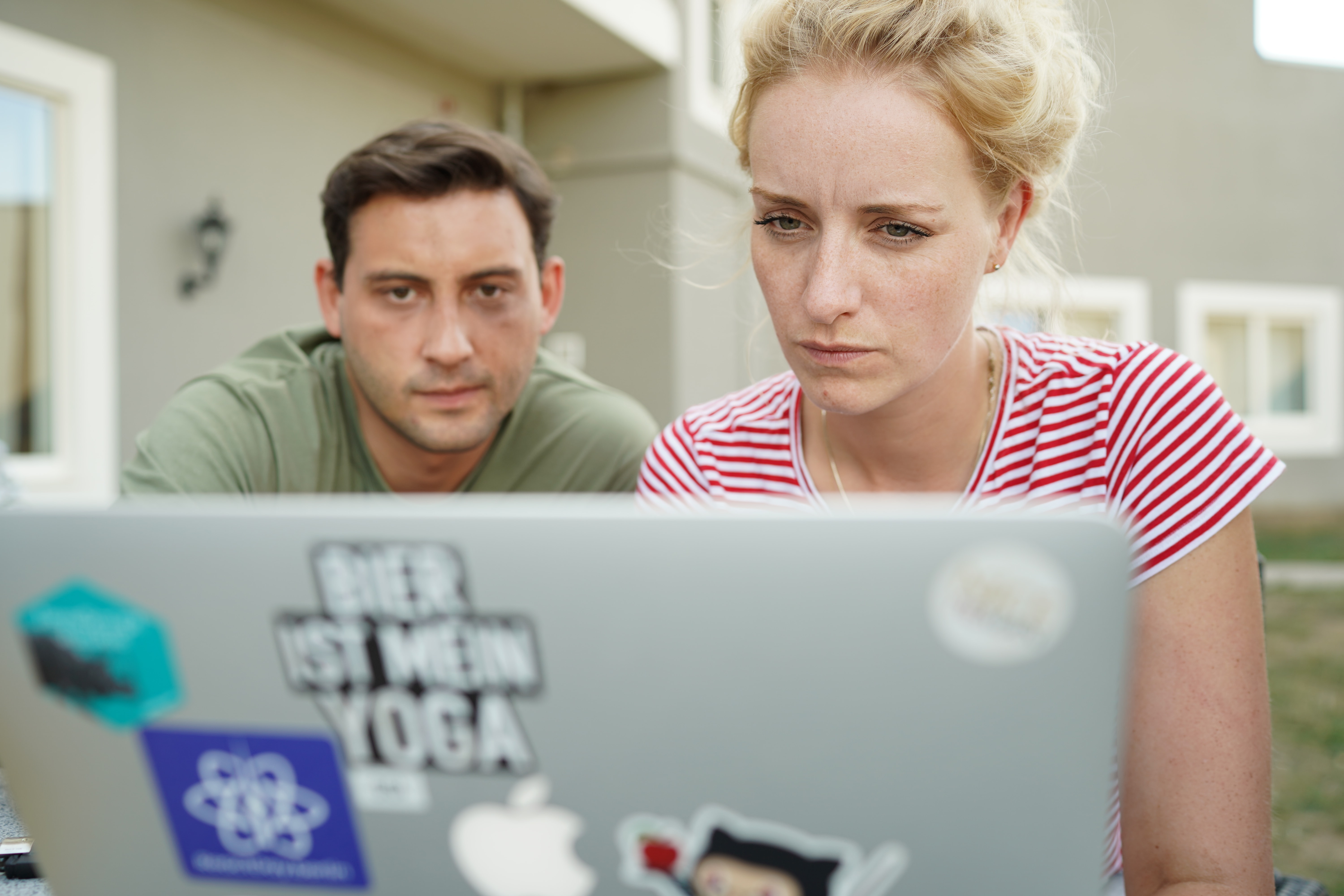 Two people looking at a laptop - code camp 2018
