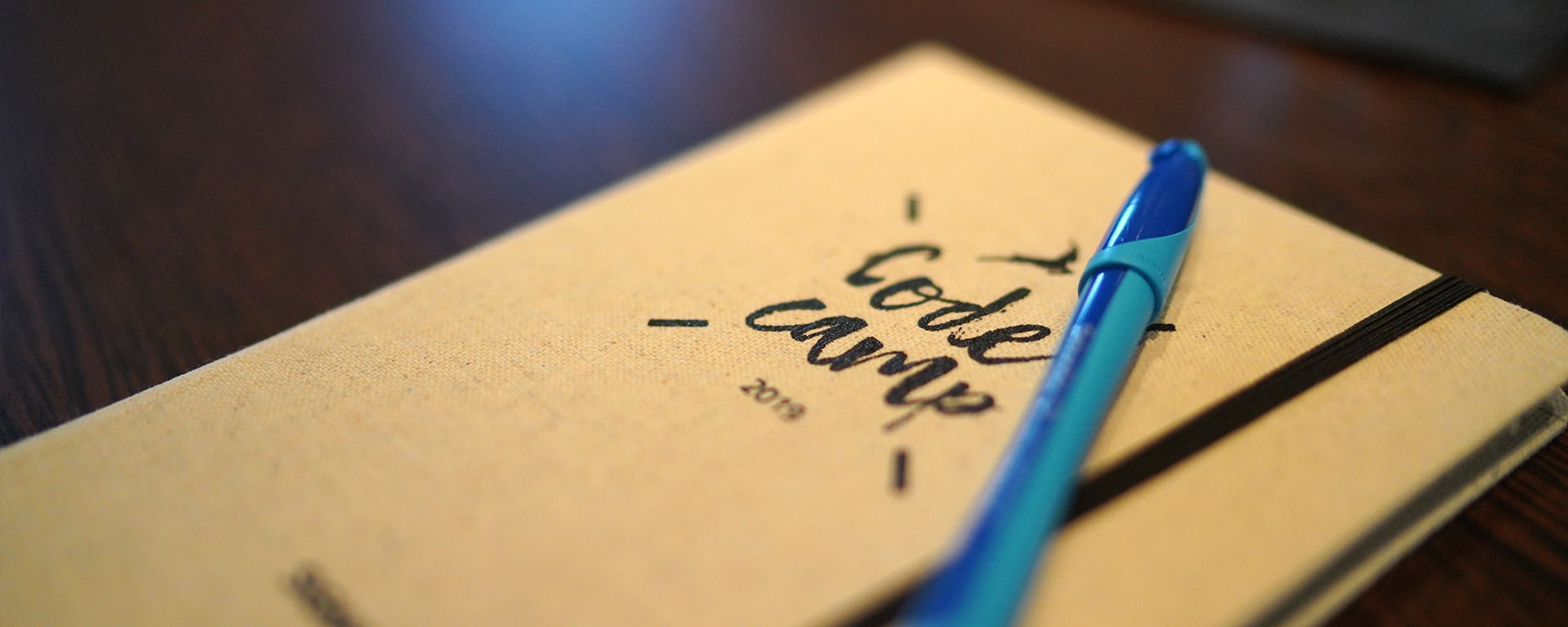 Code Camp 2019 notebook with pen